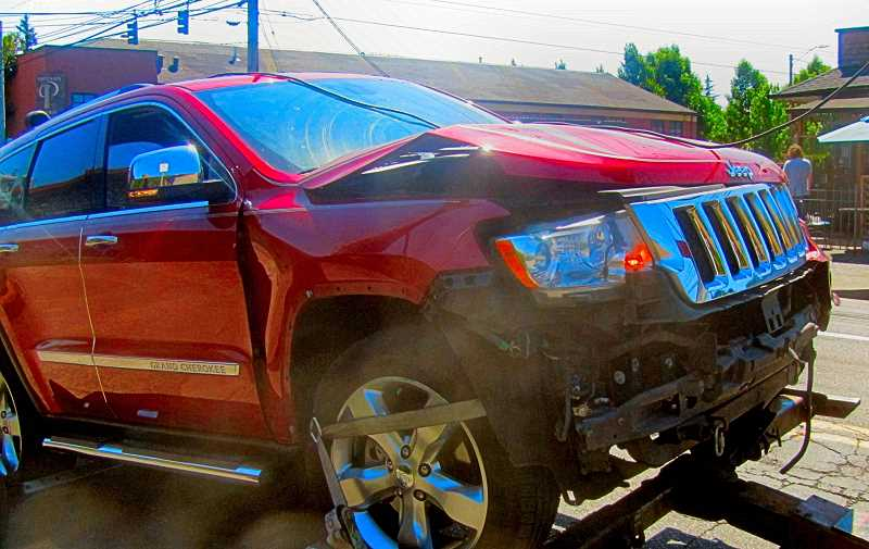 ERIC NORBERG - Its not known which driver was at fault when this Jeep Grand Cherokee T-boned a pickup truck at the intersection of Holgate Boulevard and S.E. Milwaukie Avenue, but both were obviously in the wrong place at the wrong time.