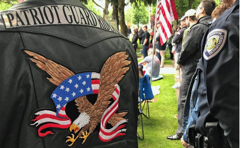 TIMES PHOTO: DANA HAYNES - Patches denoting devotion: one from the Beaverton Police Department