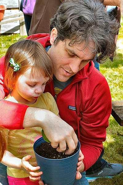 DAVID F. ASHTON - On Earth Day, in the Multnomah County Master Gardners area, Sydney Savage learned how to pot a plant start with help from her dad, John.