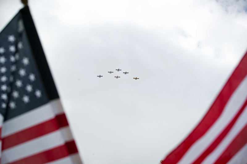 TIMES PHOTO: JAIME VALDEZ - The West Coast Ravens fly the Missing Man Formation over Tualatin...