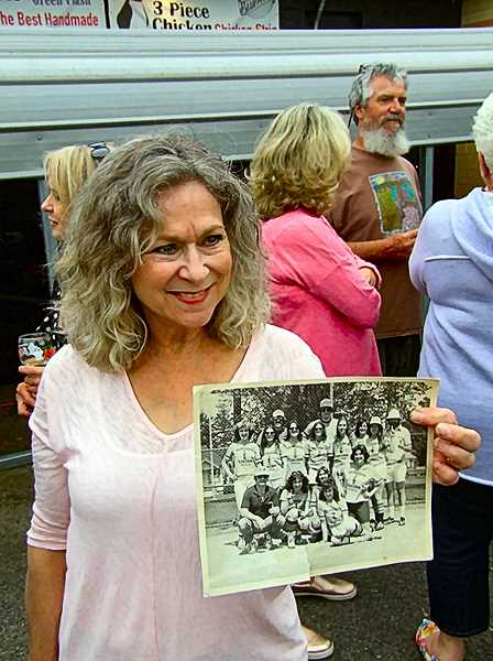 DANA BECK - Kathy Logan Ferris (Jersey #43) showing off her baseball team photo from 1974, when she played third base for the Penguins ladies baseball team.