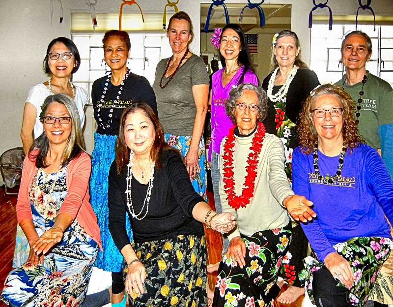 ELIZABETH USSHER GROFF - The Woodstock hula dance class participants shown here are - bottom row, left to right - Cathy Ingram, Pauline Love, Mary Ellen Andre, and Mindy Gramberg; top row, from left: Chingling Reed, Aurelia Wight, Cathy Taylor, instructor Lisa Chang, Cindy Kapiolani Selig, and Karen Williams.