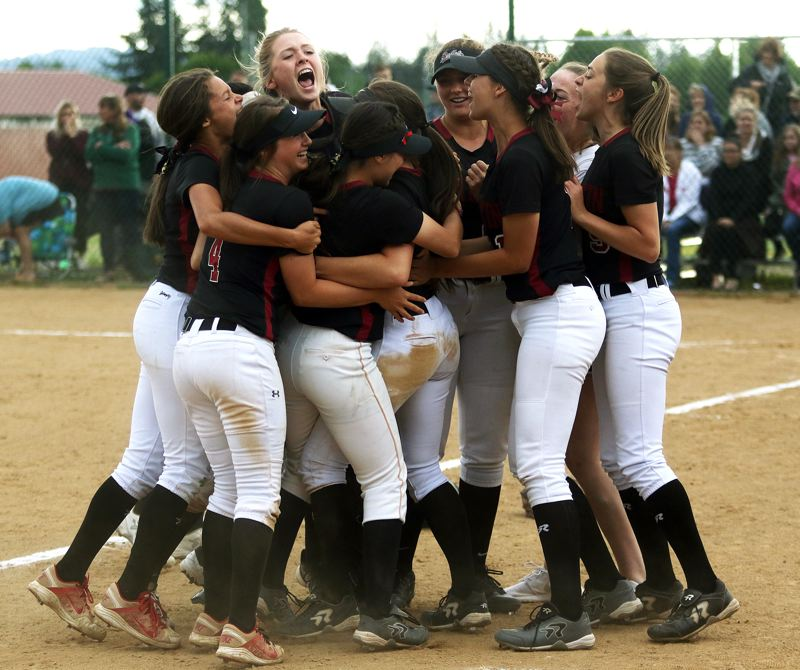 DAN BROOD - Members of the Tualatin High School softball team celebrate following the 4-2 state playoff quarterfinal win over Jesuit on Friday.