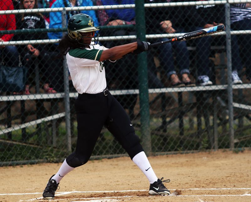 DAN BROOD - Jesuit junior Maya Williams takes a swing during the first inning of Friday's state playoff quarterfinal game.