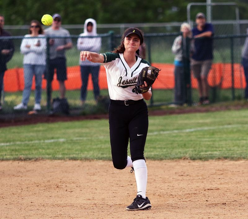 DAN BROOD - Jesuit senior shortstop Jenny Marnin makes a throw to first base during Friday's game at Tualatin.