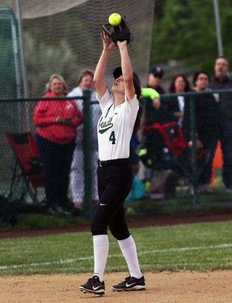 DAN BROOD - Jesuit senior shortstop Jenny Marnin catches a fly ball during Friday's quarterfinal game at Tualatin.