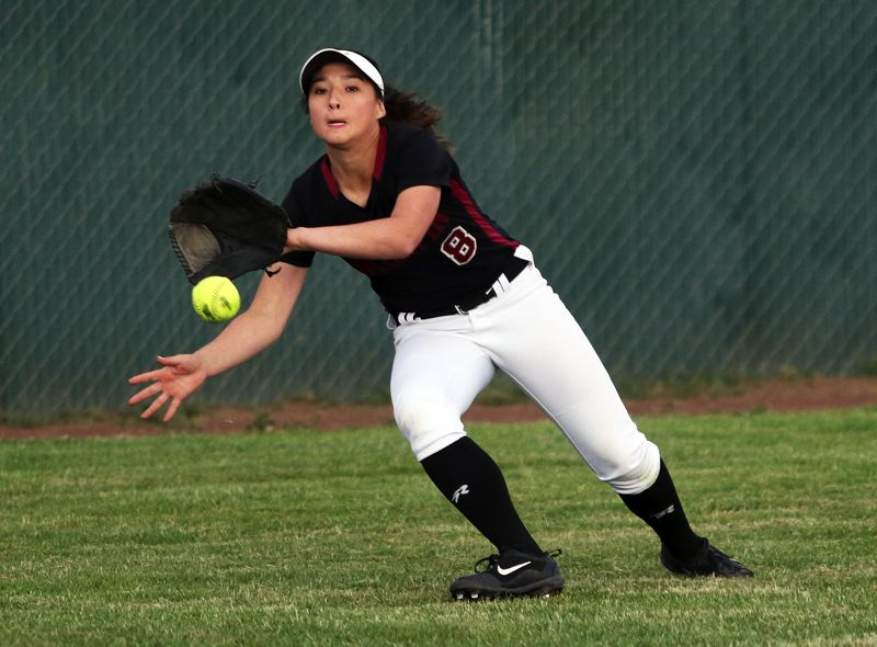 DAN BROOD - Tualatin junior left-fielder Lily Marshall goes for the ball during Friday's state playoff game.