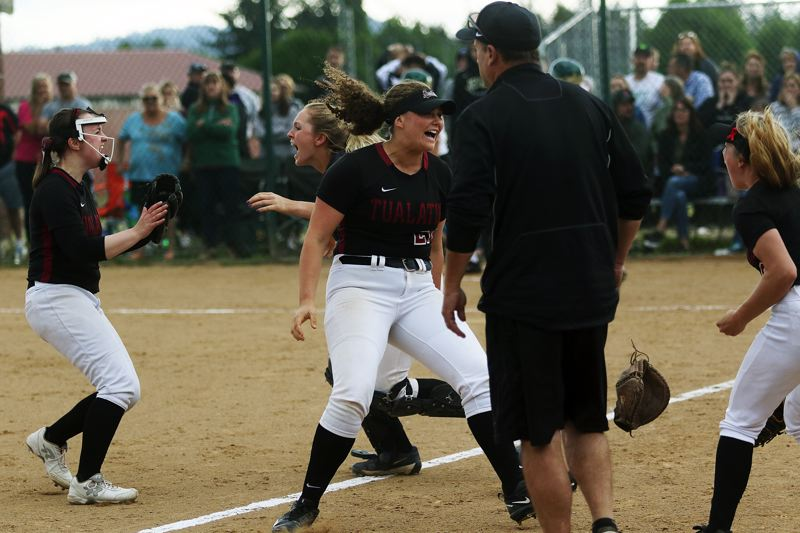 DAN BROOD - Tualatin players (from left) Megan Woodward, Ella Hillier, Emily Johansen and Kayla Laird celebrate moments after the 4-2 win over Jesuit.