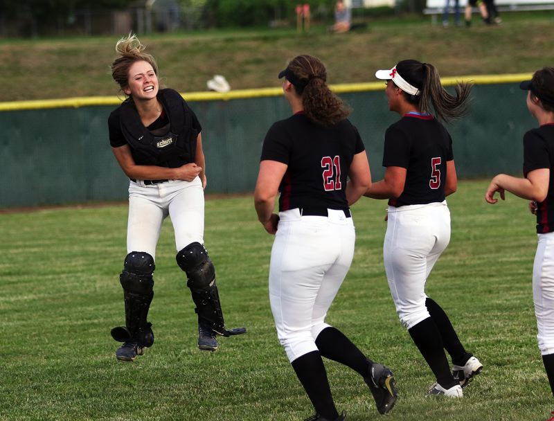 DAN BROOD - Tualatin senior catcher Ella Hillier (left) jumps in the air as the Wolves celebrate their 4-2 win over Jesuit.