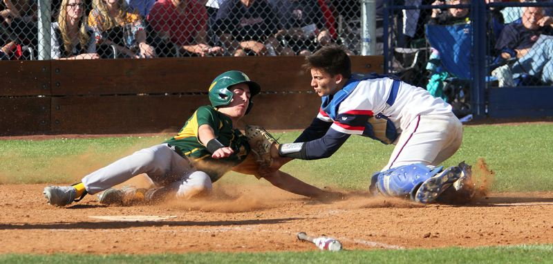 TIDINGS PHOTO: MILES VANCE - West Linn's Tate Kadel gets tagged out at home by Westview catcher Carter Sakamoto during the Lions' 5-3 loss at Westview High School in Friday's Class 6A state quarterfinals.