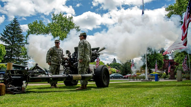 PHOTO: OREGON MILITARY DEPARTMENT - Oregon Army National Guard Soldiers with Bravo Battery, 2nd Battalion, 218th Field Artillery Regiment, based out of McMinnville, Oregon, perform a Howitzer salute during the annual Memorial Day observance.