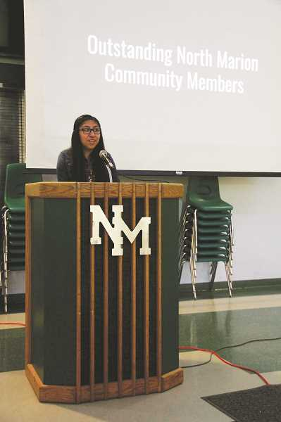 COURTESY PHOTO: SARA BAILEY - North Marion High School junior Elyse Rodriguez speaks to the attendees of the first-ever North Marion Community Recognition Night, which was held May 21 and celebrated community volunteers, parents and retiring staff.