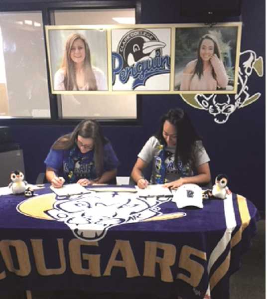 SUBMITTED PHOTO - Emily Hewitt (left) and Savannah Tuli (right) will play softball at Clark College next year.