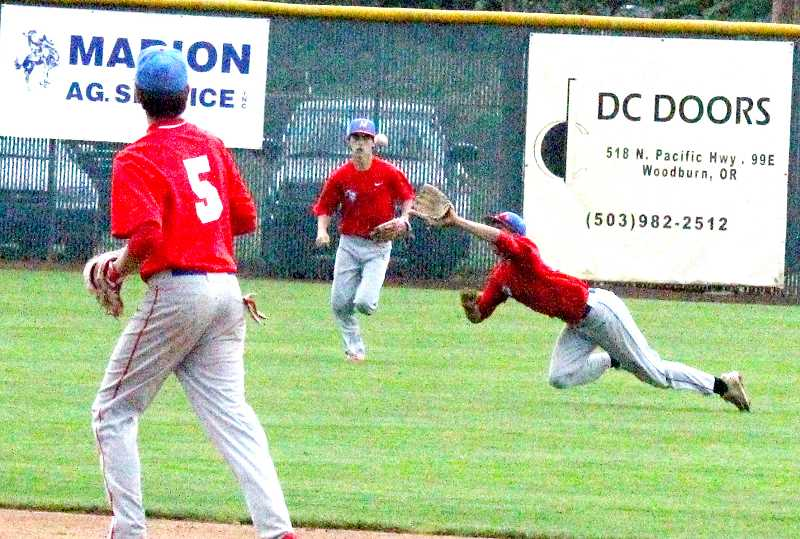 STEELE HAUGEN - Cameron Rodriguez makes a diving catch in center field.