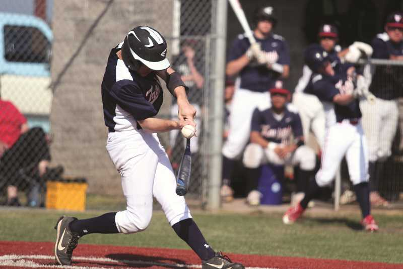 PHIL HAWKINS/FILE PHOTO - Kennedy sophomore Sam GrosJacques opened Friday's quarterfinal game up with a three-run double in the fourth inning to give the Trojans a 4-0 lead. Kennedy went on to score twice more and held off a late rally by the Oakers to win 6-3.