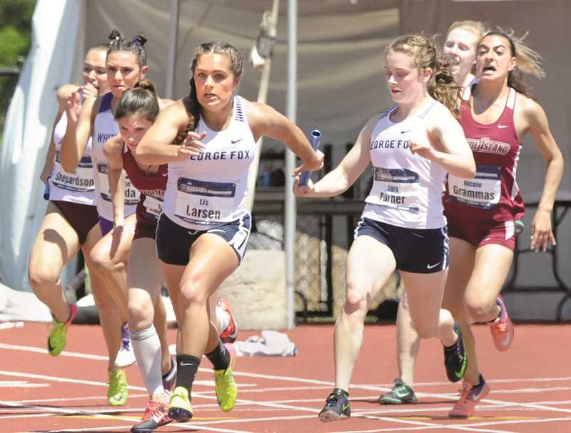 PHOTO COURTESY OF D3 PHOTOGRAPHY - George Fox freshman Sara Turner hands off to junior Lis Larsen for the final leg of the 4 x 100 relay Saturday at the NCAA Division III Outdoor Track and Field National Championships in La Crosse, Wisc. The Bruins won the event in 46.55 and went on to finish at team co-national champions with UMass-Boston.