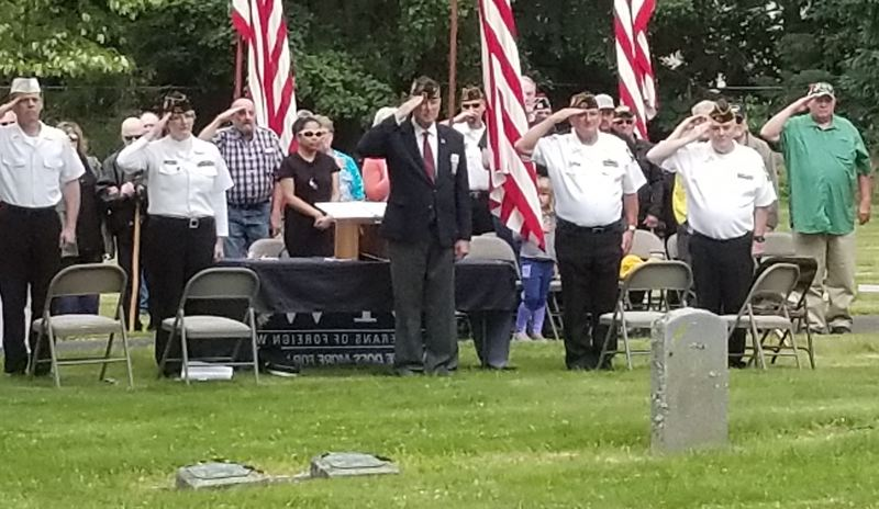 SANDY POST: STEVEN BROWN - Sandy VFW Post 4273 Commander Bert Key, center, salutes during the playing of Taps near the conclusion of Mondays Memorial Day observance at Fir Hill Cemetery in Sandy.