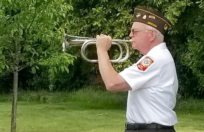 SANDY POST: STEVEN BROWN - Bugler Dick Steiner plays Taps during the Sandy VFWs Memorial Day event.