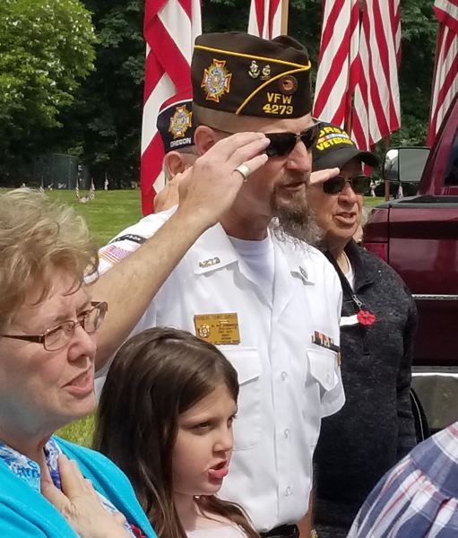 SANDY POST: STEVEN BROWN - Veteran Robert Tony Gibler salutes in preparation for reciting the Pledge of Allegiance.