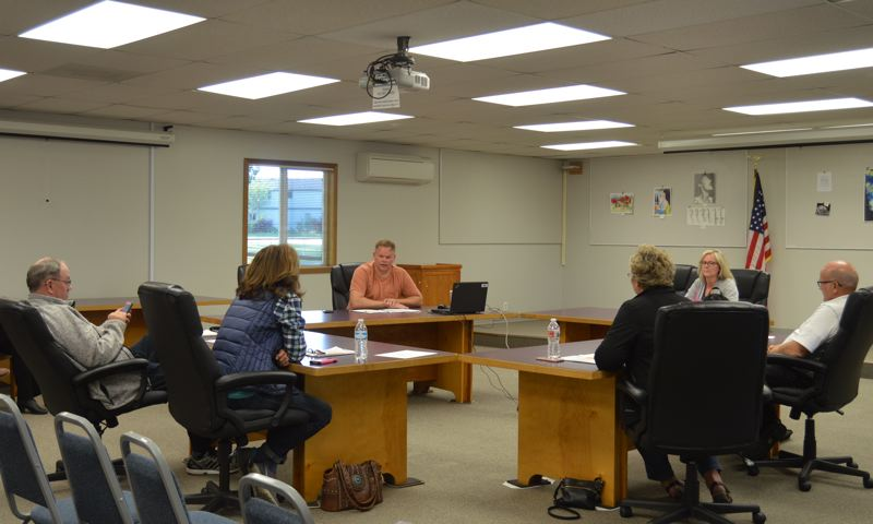 SPOTLIGHT PHOTO: NICOLE THILL - The Scappoose School Board voted Tuesday, May 29, to hire a new interim superintendent. The board voted 5 to 2 to hire Paul Peterson, a former district employee who had a discrimination lawsuit filed against him during his tenure from 2006 to 2011.
