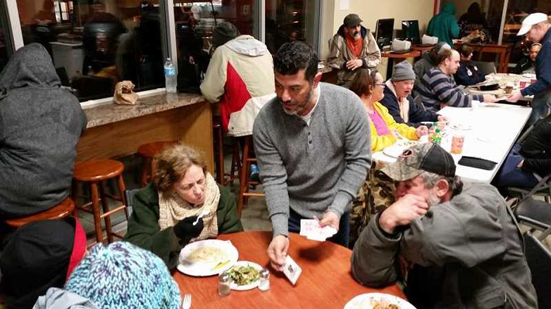 COURTESY PHOTO: OLD TOWN CHURCH  - Many community members volunteer at the emergency shelter during the winter by cooking, supervising or just providing social support.