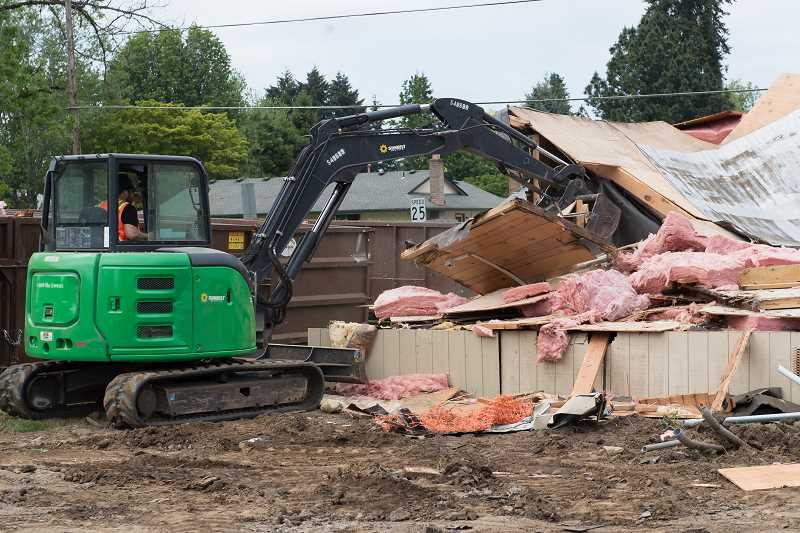 STAFF PHOTO: CHRISTOPHER OERTELL - Justin Dawson from INLINE Commercial Construction used a backhoe to demolish an old portable classroom at Reedville Elementary on Tuesday, May 15.