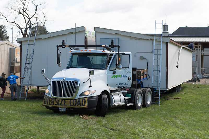 STAFF PHOTO: CHRISTOPHER OERTELL - Two of the newer and still usable portables were transferred to nearby schools to use in the upcoming school year as Reedville prepares for a new modular building in the space.