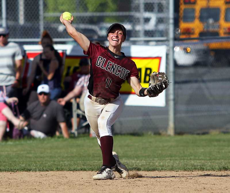 PMG PHOTO: DAN BROOD - Glencoe's Morgan DeBord throws a ball from her shortstop position during the Tide's second round playoff game against Tigard May 23, at Glencoe High School.