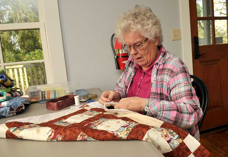 SPOKESMAN PHOTO: VERN UYETAKE - The Wilsonville Piecemakers quilting group meets at the Tauchman House.