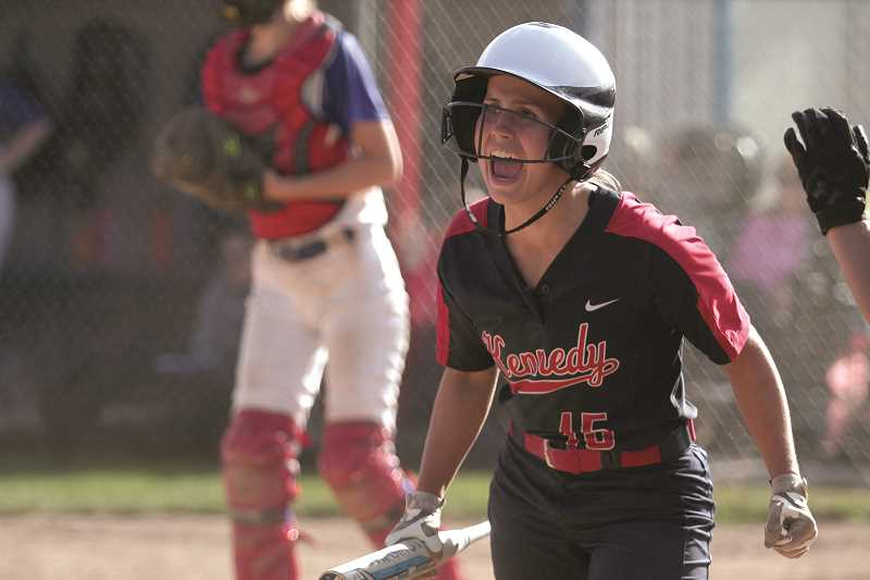 PHIL HAWKINS - Kennedy freshman Hailey Arritola cheers on her sister, Hannah Arritola, who drove her in with a two-RBI triple as part of the Trojans' five-run sixth inning in their 10-1 win over Central Linn.
