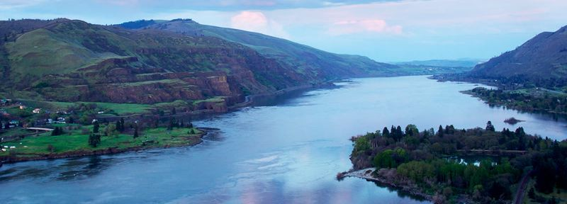PHOTO BY WARREN MORGAN, COURTESY OF FRIENDS OF COLUMBIA GORGE - Twilight in the gorge, viewed from Rowena Crest on the Oregon side of the Columbia River. The town of Lyle, Washington, one of the Gorge's 13 designated Urban Areas, is visible at left.