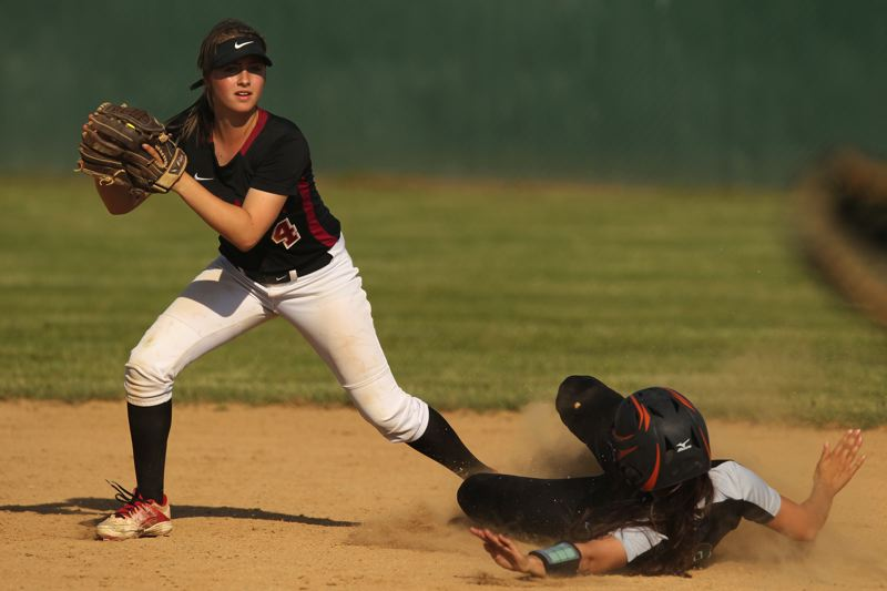 TIMES PHOTO: JAIME VALDEZ - Tualatin sophomore shortstop Bella Valdes forces out a West Salem runner.