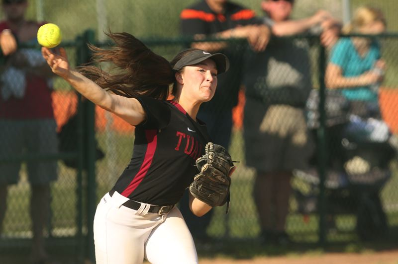 TIMES PHOTO: JAIME VALDEZ - Tualatin senior third baseman Taylor Alton rifles a throw to first base in the win over West Salem.