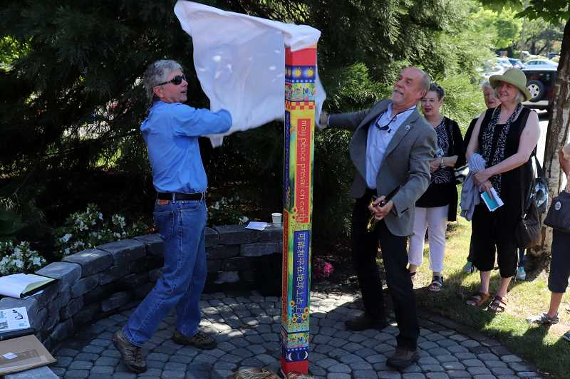 SUBMITTED PHOTOS: ANDREW KILSTROM - David Goode and Mayor Russ Axelrod unveil the peace pole.