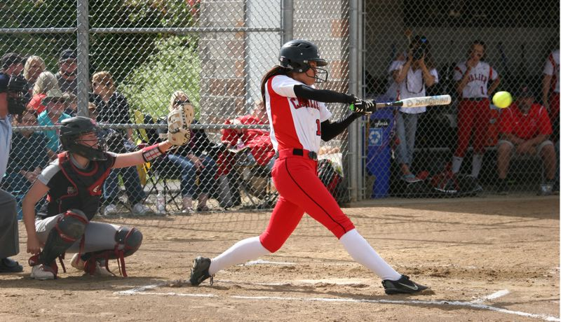 PAMPLIN MEDIA: JIM BESEDA - Clackamas' Alyssa Daniell hit a two-run homer that broke a 5-5 tie in the fourth inning of Tuesday's OSAA Class 6A softball semifinal against North Medford at Clackamas High School.