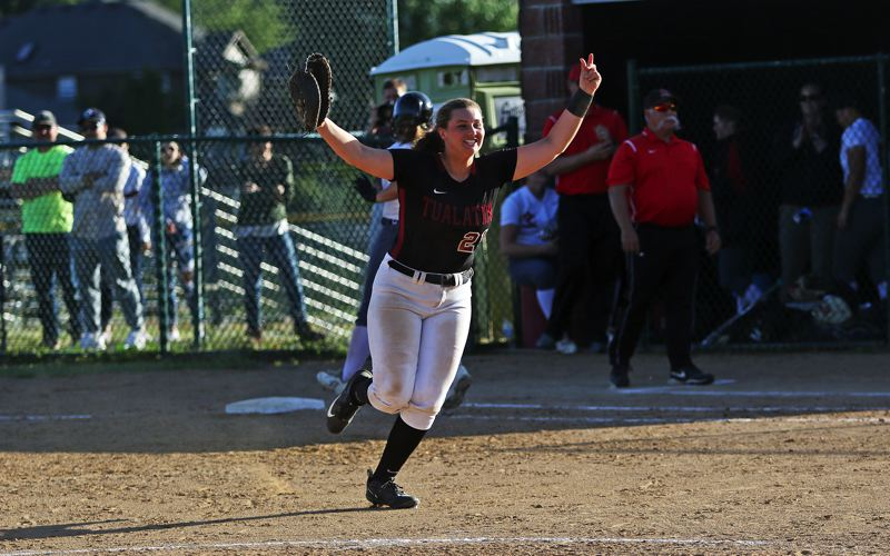 TIMES PHOTO: DAN BROOD - Tualatin High School junior Emily Johansen sprints to join her teammates following the final out of the Wolves 8-5 semifinal win over Oregon City.