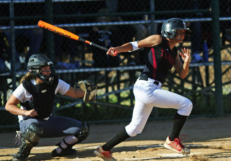 TIMES PHOTO: DAN BROOD - Tualatin HIgh School sophomore Tia Ridings rips a leadoff single in the bottom of the third inning of Tuesdays semifinal game.