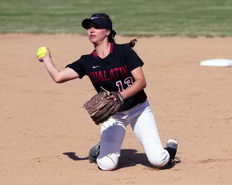 TIMES PHOTO: DAN BROOD - Tualatin junior second baseman Andrea Gomez makes a throw to first base from her knees in the state playoff win over Oregon City.