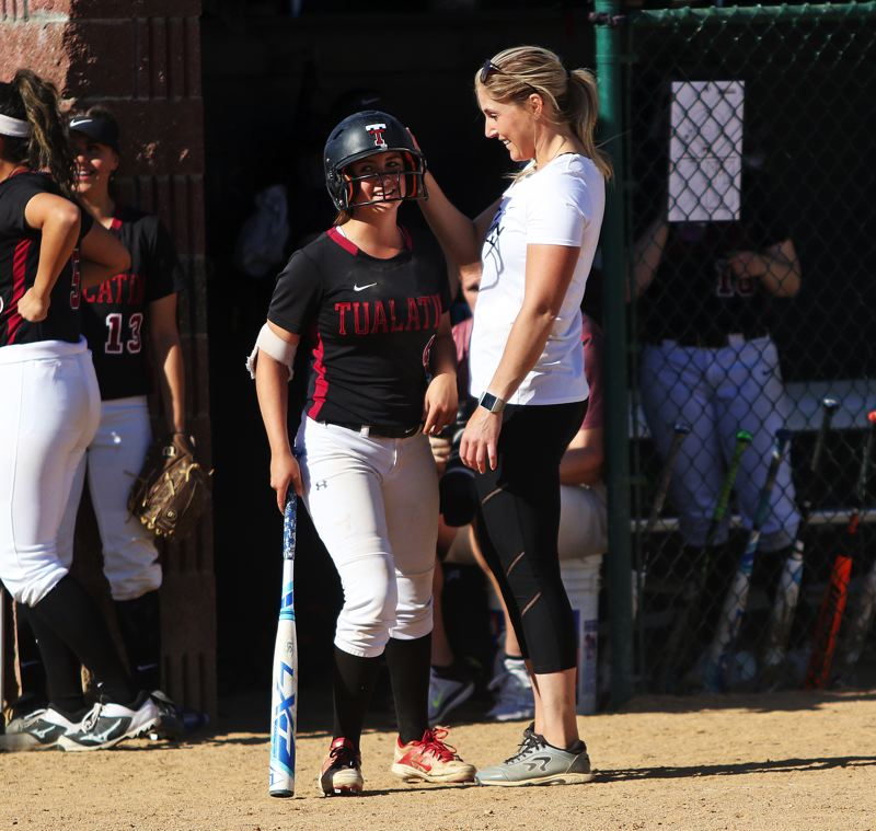 TIMES PHOTO: DAN BROOD - Tualatin head coach Jenna Wilson talks to sophomore Bella Valdes before her at-bat in Tuesday's state playoff quarterfinal game.