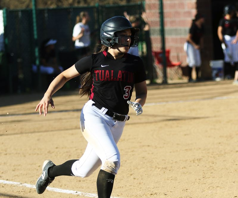 TIMES PHOTO: DAN BROOD - Tualatin senior Taylor Alton sprints to first base after hitting a two-run single during the Wolves' win over Oregon City.