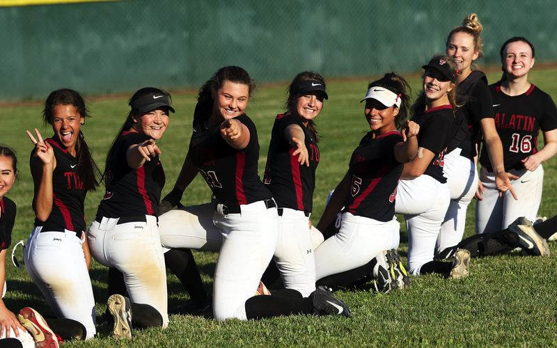 TIMES PHOTO: DAN BROOD - The Wolves, including (from left) Tia Ridings, Taylor Alton, Emily Johansen, Bella Valdes, Zoe Olivera, Kayla Laird, Ella Hillier and Megan Woodward are all smiles following the 8-5 state playoff semifinal win over Oregon City.