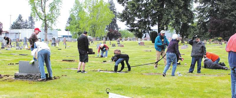 SUBMITTED PHOTO - Volunteers from six Canby organizations cleaned historic grave markers at Zion Memorial Cemetery on May 12.