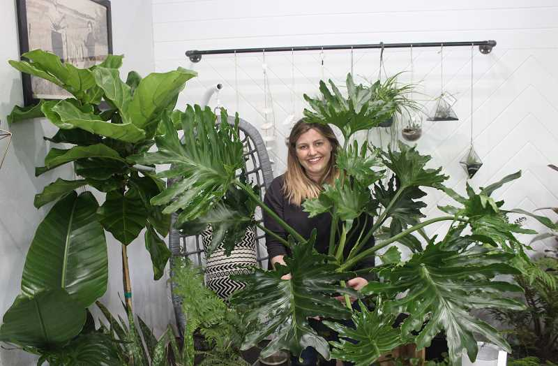 CONNECTION PHOTO: COREY BUCHANAN - Gurton's plant shop owner Julina Abbott hopes to help customers install plants into their home or workspace.