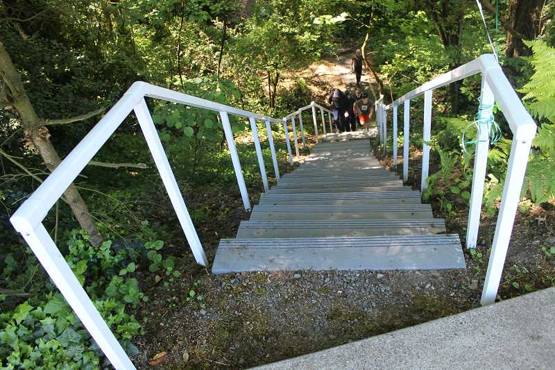 CONNECTION PHOTO: COREY BUCHANAN - A new handrail and steps were added to a steep trail that connects Robert Gray Middle School to Hillsdale neighborhood.