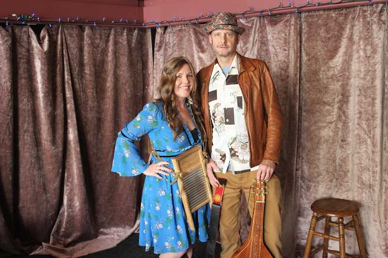 CONNECTION PHOTO: COREY BUCHANAN - Southwest Portland residents Melinda Hasting (left) and John Baker are two-thirds of the band Mojo Heller.