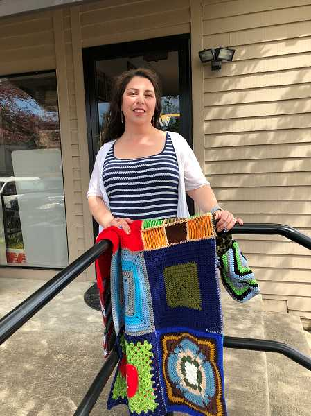 STAFF PHOTO BARB RANDALL  - Sandra Breuer has founded Yarnivores4Vets, a nonprofit organization focused on knitting or crocheting blankets and more for veterans. She invites other knitting or crocheting enthusiasts to join the effort.