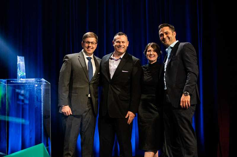 SUBMITTED PHOTO  - Microsoft's VP Partner Development Kelly Thomas Nojaim (second from right) awards Logical Positions team of, from left, Kevin Zechenelly, Tony Palazzo and Michael Weinhouse numerous awards including Partner of the Year at the Global Bing Partner Awards.