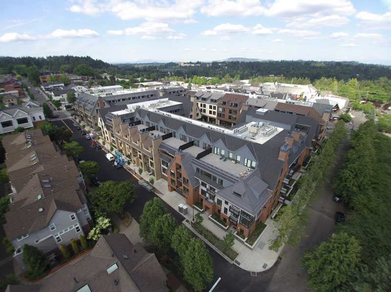 PHOTO COURTESY OF LEASE CRUTCHER LEWIS - Residents and retailers have started moving in to The Windward in downtown Lake Oswego. This aerial view looks northwest from the corner of Second Street and Evergreen Road.