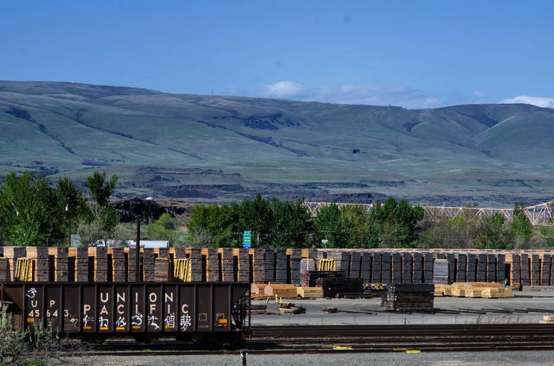PHOTO BY SARAH CLARK, COURTESY OF CASCADIA TIMES  - Union Pacific Railroad purchases railroad ties from AmeriTies West, LLC in The Dalles. Wooden railroad ties are stacked in the yard awaiting processing. Ties are soaked in creosote, a toxic preservative, before being installed on the railroad.