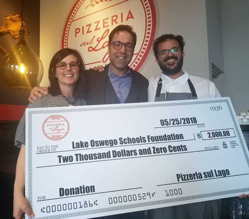 REVIEW PHOTO: GARY M. STEIN - Lake Oswego Schools Foundation Executive Director Mary Kay Larson accepts a $2,000 donation from Pizzeria sul Lago General Manager Tim Mattera (center) and Executive Chef Nick Ford.